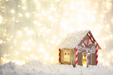Christmas and New Year greeting card. Christmas concept. gingerbread house on the background of garlands