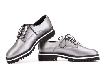 Shoes in silver-metallic color.