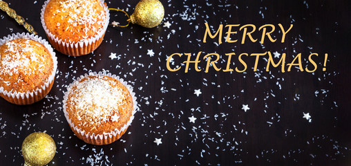 Homemade lemon muffins decorate coconut powder dark background. New year and Christmas concept. Selective focus.
