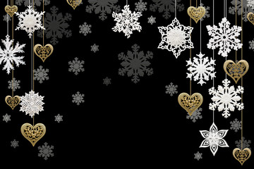 Christmas and New Year decorations: snowflakes and golden hearts on black background. Isolated, black background.