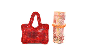 Red bag and money on white background close up