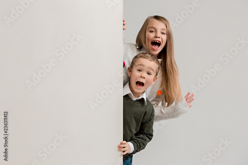 f981701ca66 Banner with a surprised children peeking at the edge with copyspace. The  portrait of cute