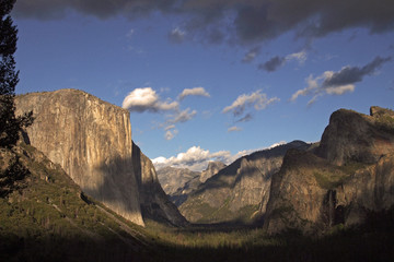 view over Yosemite Valley at early evening from Wawona Tunnel vista point with El Capitan on the left, Half Dome on axis and Bridalveil Fall on the right, California, USA