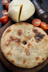 Close-up of ossetian pie with meat stuffing, selective focus, vertical shot