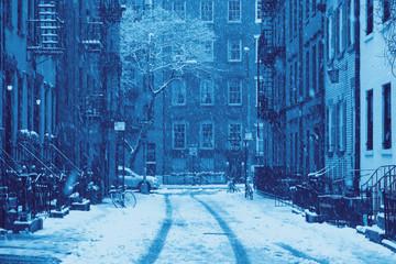 Snowy winter blizzard scene on Gay Street in the Greenwich Village neighborhood of New York City in blue