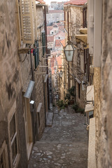 Foto op Plexiglas Smal steegje Narrow medieval alley with downstairs view in Dubrovnik in winter, Croatia