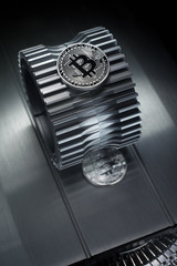 Bitcoin Silver coin lies on the gearwheel.