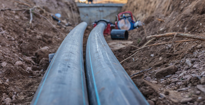 sewer pipes with water are laid underground