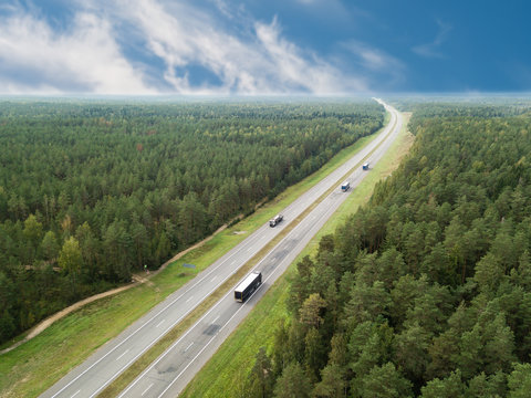 aerial photo highway road autobahn trucking, car rides on the highway