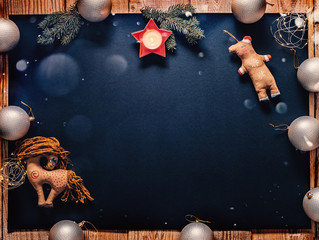 Christmas decorations on black. Top view. Flat lay. Copy space