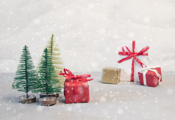Red Christmas balls,gift boxes and fir tree on snow