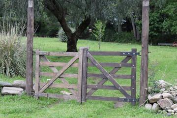 vintage closing wooden gate on a farm in the village