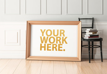 Wooden Framed Poster Leaning on White Wall Mockup