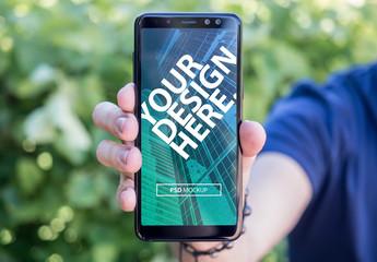 Smartphone in Hand Mockup