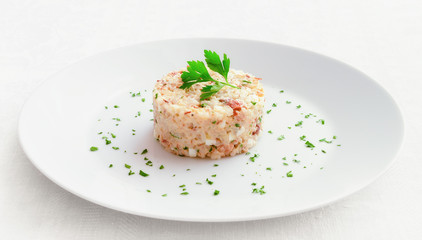mayonnaise salad with mackerel, egg, onion and rice decorated with parsley