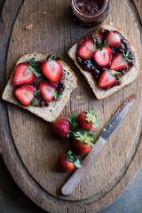 Strawberries and jam on toast
