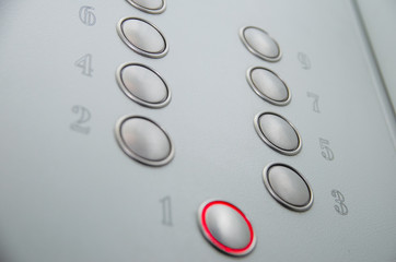 Close-up of blind person finger reading braille on elevator lift panel