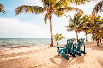 Chairs on tropical beach