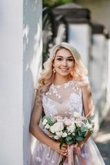 Photo shoot of the newlyweds on the street. Kirov Avenue. Saratov.