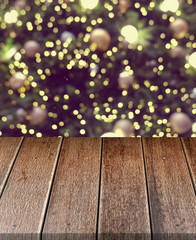 Empty old wooden table in front of Christmas or happy new year time background. christmas tree with colorful balls holiday background. Product display montage