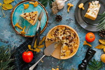 High angle view of quiche with ingredients served on wooden table