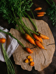 High angle view of carrots with cutting board on table