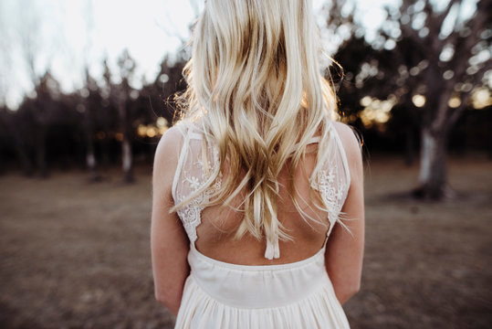 Rear view of girl wearing white dress