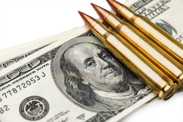 on the banknotes of dollars are fighting bullets close-up. Concept of war and money