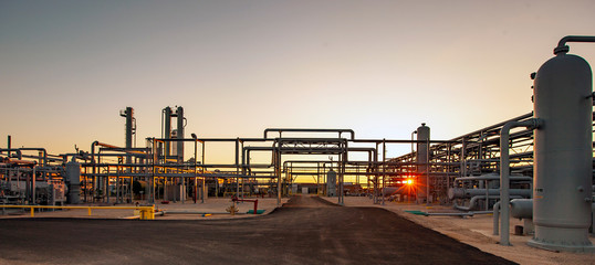 Petrochemical plant against clear sky at Permian Basin during sunset