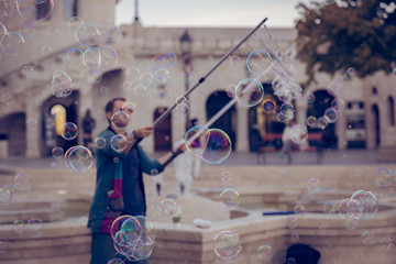 A man making soap bubbles around Buda Castle, Budapest, Hungary