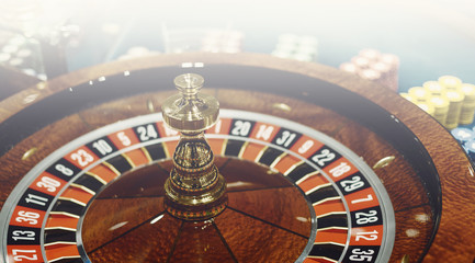 Wooden casino roulette wheel, black and red numbers. Luck games.