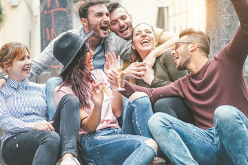 Fototapeta Happy friends doing party drinking champagne at sunset outdoor - Young millennial people having fun celebrating birthday and laughing together - Friendship and youth holidays lifestyle concept obraz
