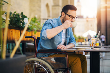 Handicapped man enjoying coffee