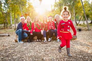 Christmas Themed Multiethnic Family Portrait Outdoors