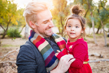 Handsome Caucasian Young Man with Mixed Race Baby Girl Outdoors