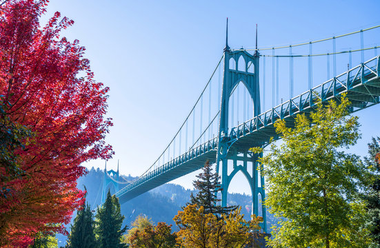 Arched stylish St Johns bridge in Portland in the colors of autumn trees