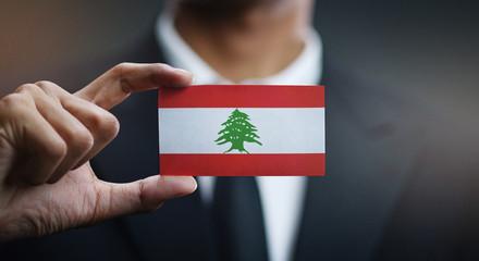 Businessman Holding Card of Lebanon Flag