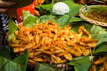 spicy fried shrimp served in green banana leaf from central java