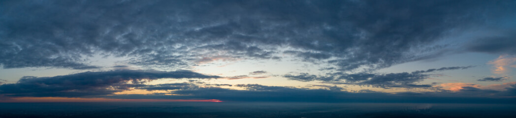 Panorama of clouds at sunset