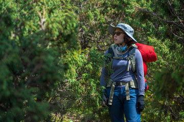Lady backpacker or trekker with backpack lost in jungle in Nepal