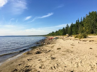 The beautiful sandy beaches along Marten Beach and the waters of slave lake in Northern Alberta, Canada on a warm summer day.