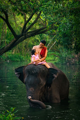 Happy dad and daughter sitting on the elephant, Thailand
