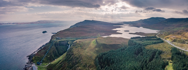 Aerial view of the very steep sea cliffs at Bearreraig Bay with the storr lochs in background - Isle of Skye , Scotland