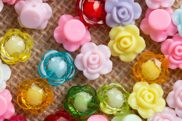 Colorful flower plastic beads on wooden
