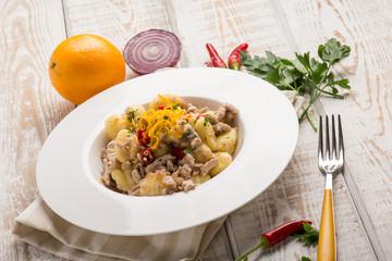 gnocchi with tuna onion and orange grated peel