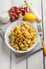 pasta with leek cream sauce pomegranate and lemon peel