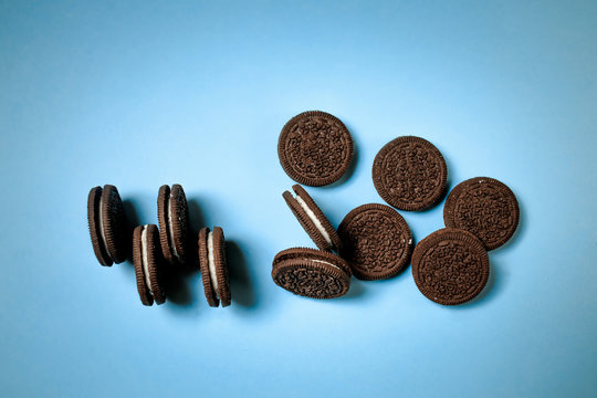 Oreo cookies, chocolate cream filling sandwich cookies on a blue background