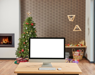 Decorative modern Christmas tree close up desktop screen on the wooden desk.