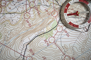 compass on the background of the map