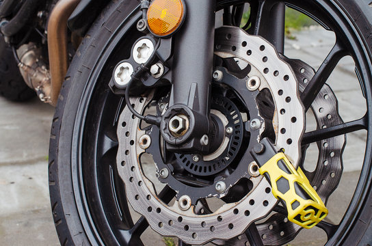 theft protection is mounted on the motorcycle brake disc